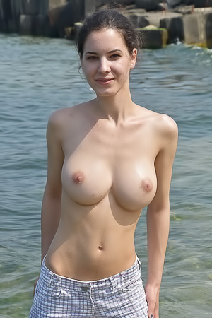 Lucie topless on the shore